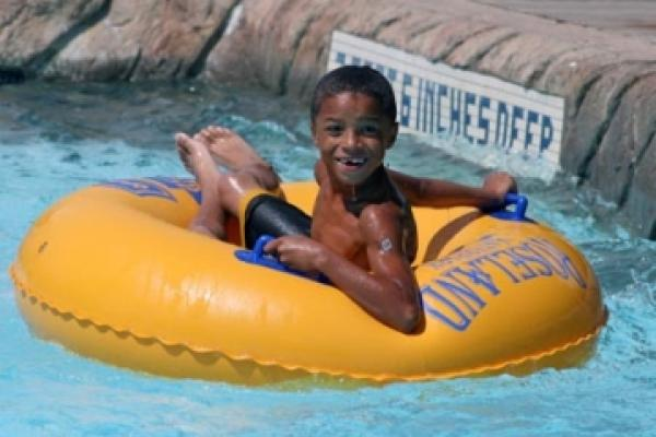 kid in tube on lazy river