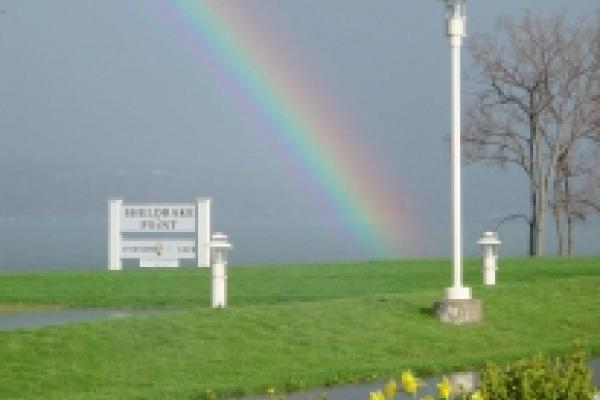 rainbow over sign