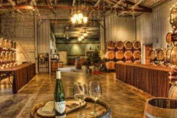 tasting room interior with wine barrels