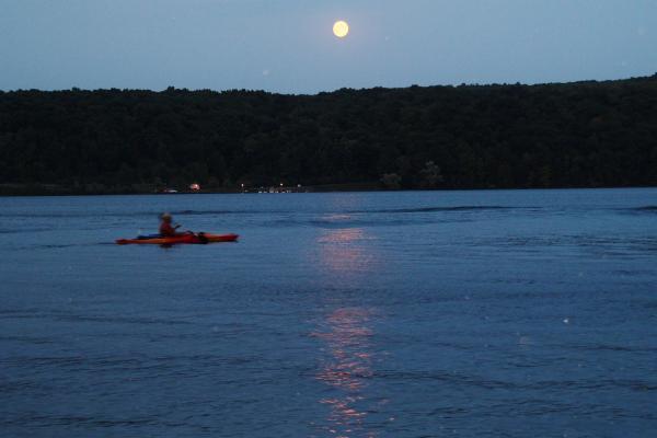 Paddler in Kayak on Keuka Lake in evening.
