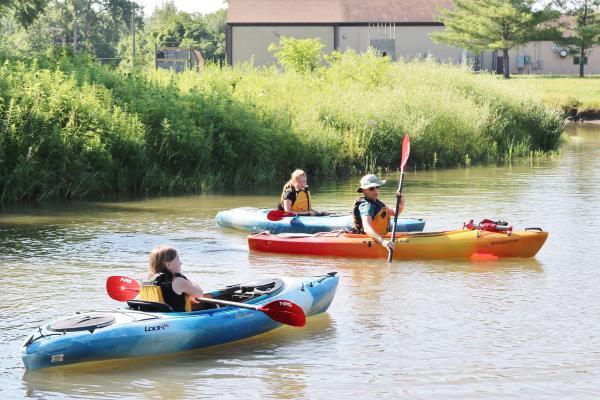 People in Kayaks in Sugar Creek.