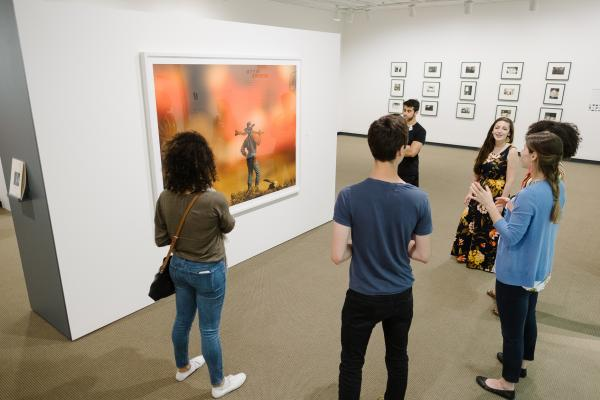 Group looking at David Levinthal's work
