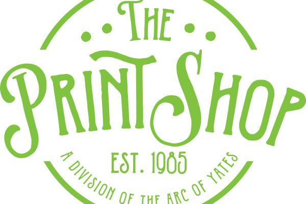 green text with surrounding white circle for The Print Shop as logo