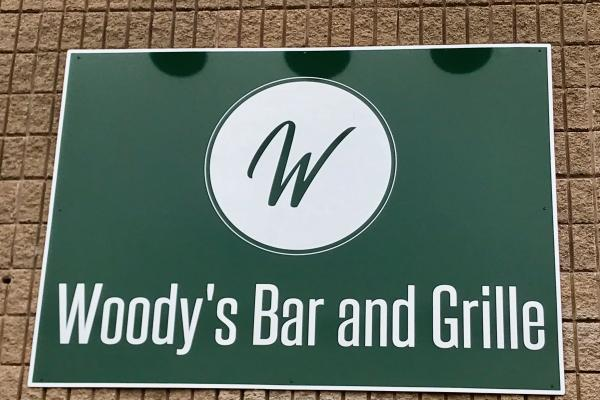 woody bar & grille sign