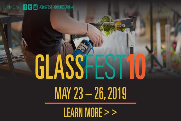 gaffer blowing glass on modeling rod with yellow glass text overlaid, blue fest text, and red 10 then yellow dates of event, May 23-26, 2019 on second line below glassfest 10 text