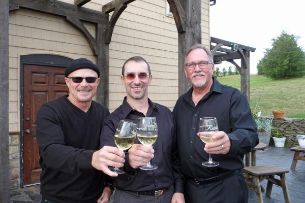 Band Members in Artistic License toast a glass of Keuka Spring wine