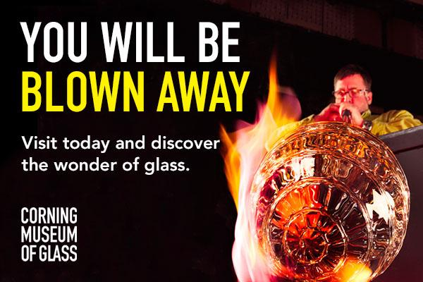 black background with gaffer blowing glass bulb at end of tube, white text at top left ' You Will Be'  with yellow text underneath 'Blown Away'