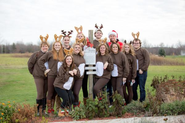 People dressed up as reindeer for Deck the Halls event