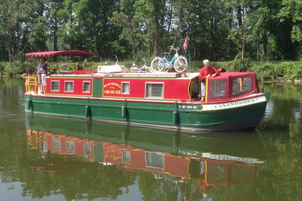 red and green canal boat on the water