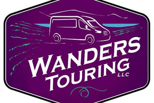 wanders touring logo purple with white lettering