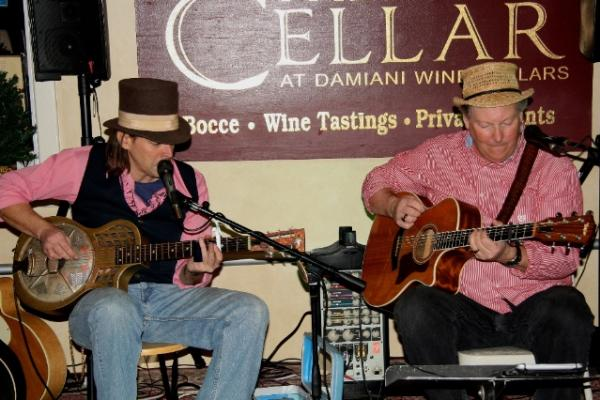 The Bollicini Brothers on Cellar stage playing guitar