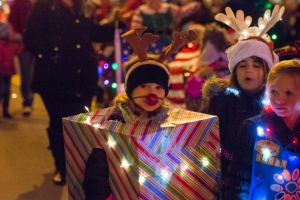 children in costume for parade of lights