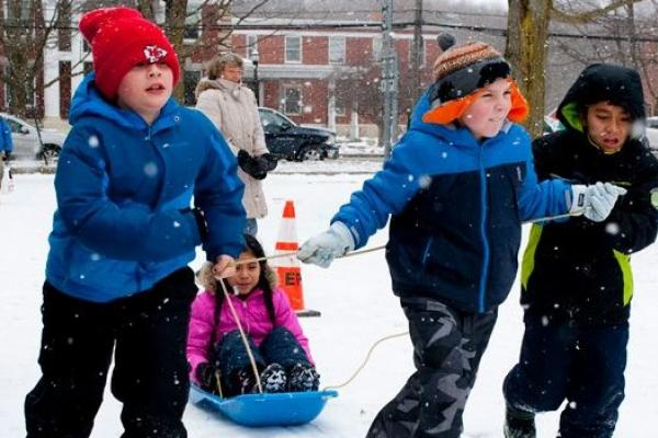 children playing in the snow