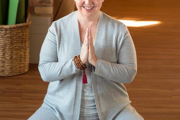 Laura Coburn in yoga pose