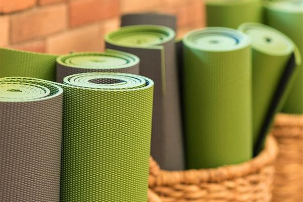 Green and Grey yoga mats in baskets