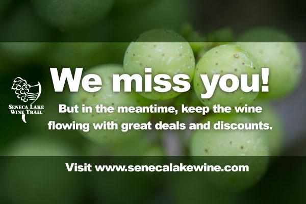 close up of green grapes in background with white overlay text saying 'We Miss You!'