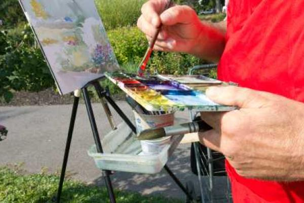 Artist with paint and easel