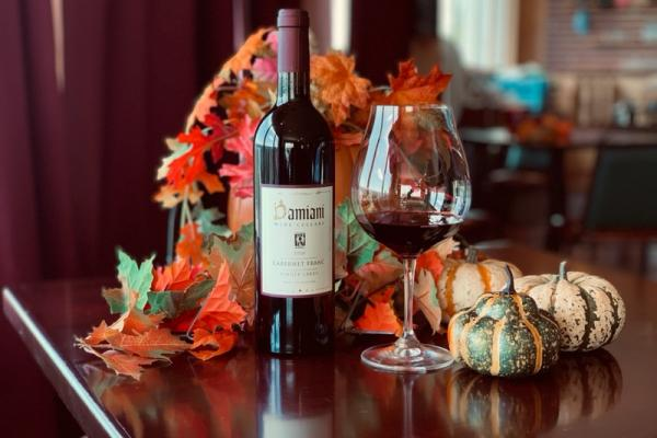 Damiani Cabernet Franc on a fall decorated table.