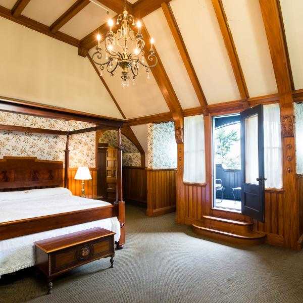 tower suite with framed bed and lofted ceilings