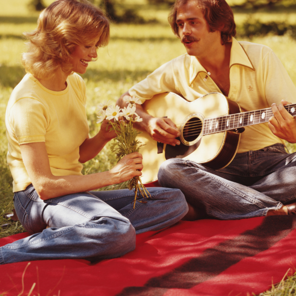 Retro couple playing guitar