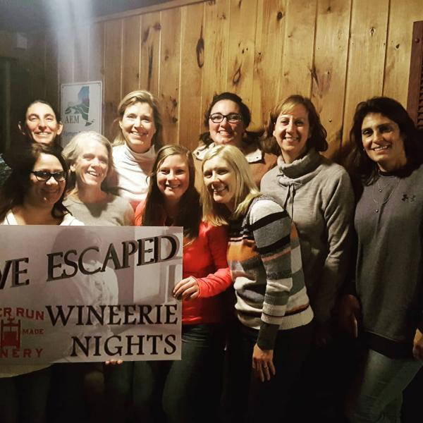 Deer Run Winery customers holding a sign saying We Escaped