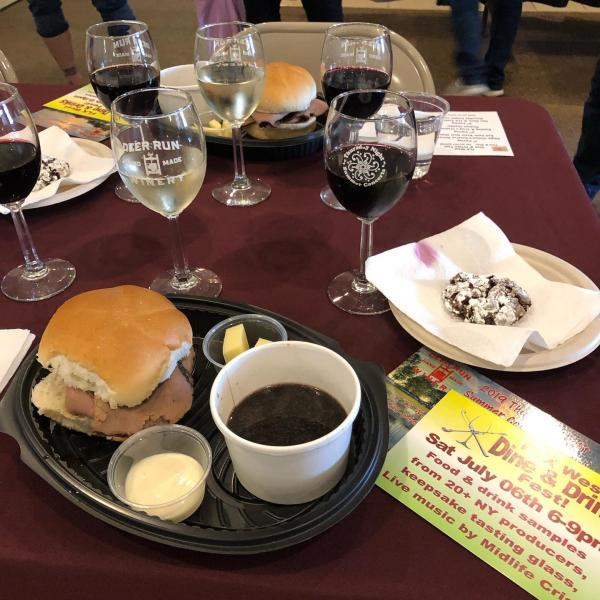 flight of 3 wines with a plate with Red Osier roast beef sandwich, Craig's creamery cheese and a Finger Lakes Cookie Co. cookie