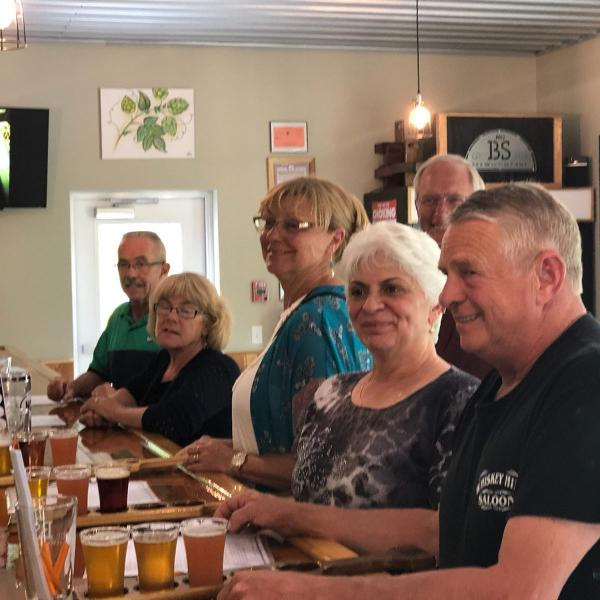 customers enjoying a flight of beer at No BS Brewery