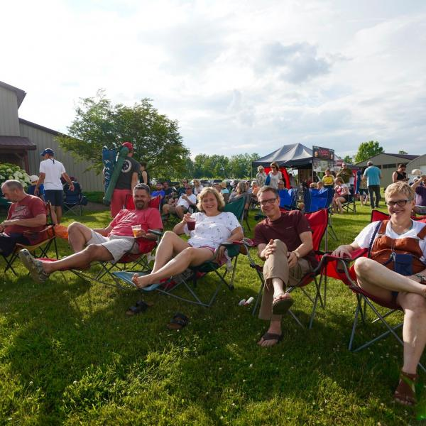 customers relaxing in camp chairs at a concert at Deer Run Winery