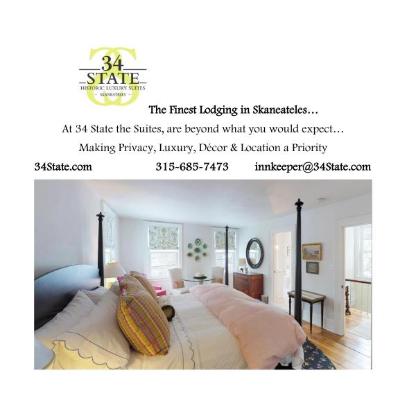 34 state green text logo at top left corner and image of bedroom and large king bed with pillow at footer of image