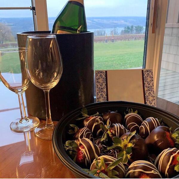 Wine glasses and chocolate covered strawberries in one of our rooms, overlooking the vineyard and Seneca Lake
