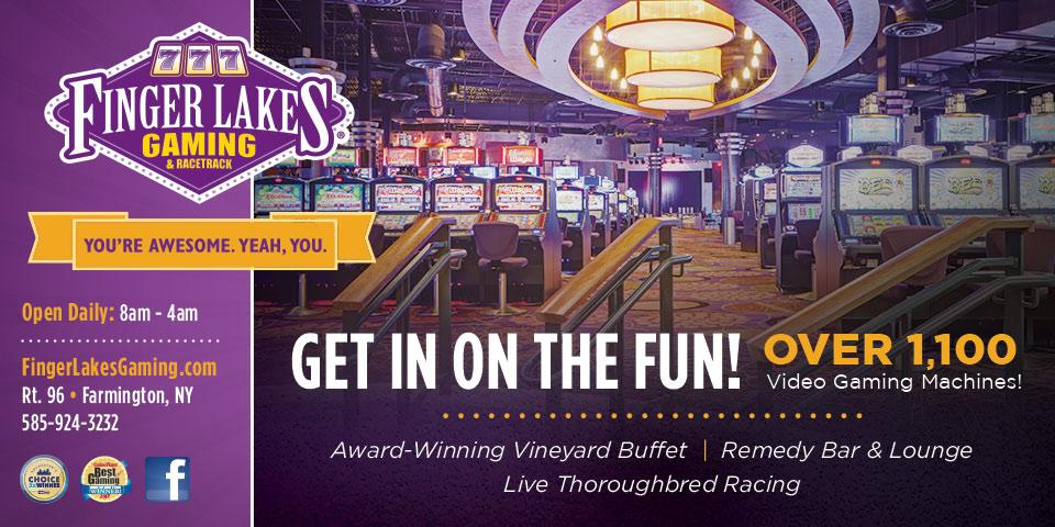 Finger Lakes Gaming logo in purple and gold at the top left corner, chandelier hanging in middle with slots underneath