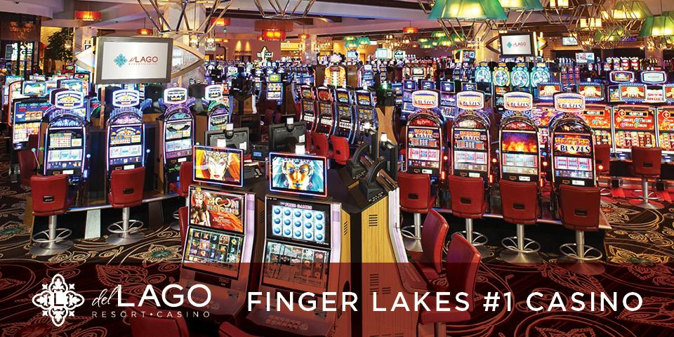 slot machines on floor with lots of colors and white text at bottom saying 'Finger Lakes #1 Casino'